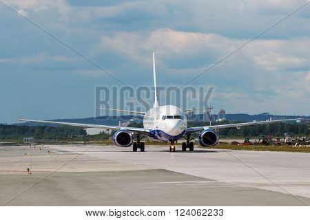 modern aircraft on the runway summer day