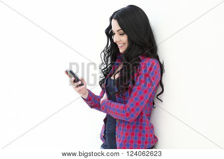 Young Woman Holding A Smart Phone While Text Messaging