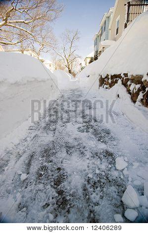 Snowy Side Walk In Neighborhood