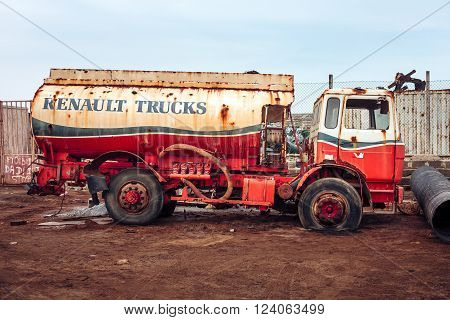 SANTA MARIA, CAPE VERDE - DECEMBER 17, 2015: Renault Cistern truck abandoned at the scrap-heap. Red rusty car