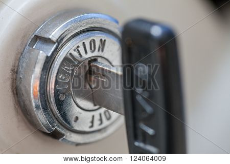 Close up shot of a motorcycle key hole, ignition switch.