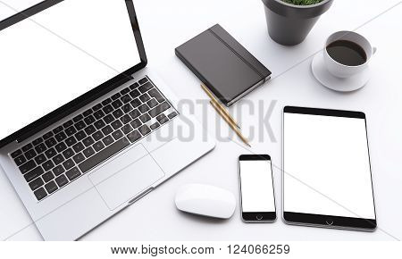 Laptop smartphone and tablet with white screens coffee mouse datebook and plant on table. Concept of work. Mock up. 3D rendering