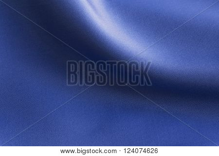 Shiny Blue silky fabric folds background texture