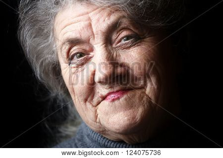 Happy granny face on a black background