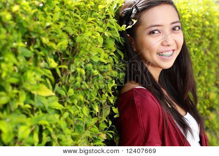 sweet young woman with toothy smile