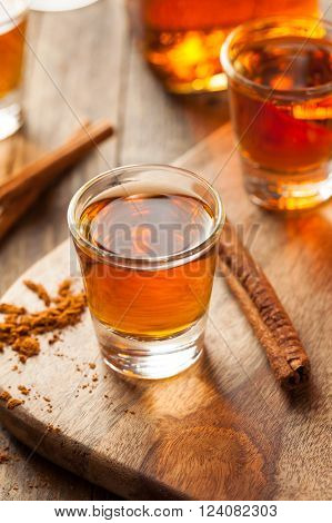 Cinnamon Whiskey Bourbon in a Shot Glass Ready to Drink ** Note: Shallow depth of field