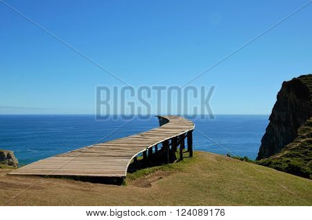 Coastal view onto the Muelle de las Almas bridge with the ocean in the background poster