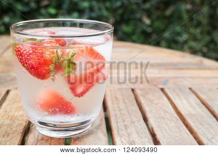 Close-up glass of strawberry infused water stock photo