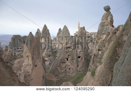Ancient cave town at the foot of the uçhisar castle. Cappadocia, Turkey