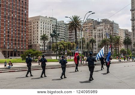 Montevideo Uruguay - December 15 2012: State Police march in the parade in the heart of downtown Montevideo in the Plaza Independencia Montevideo Uruguay.