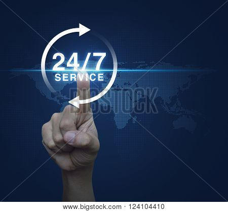 Hand pressing button 24 hours service icon over digital world map blue background Full time service concept Elements of this image furnished by NASA
