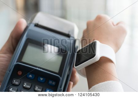 Woman using Smartwatch pay by NFC