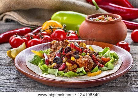 Stew from various vegetables and meat. Mexican cuisine.