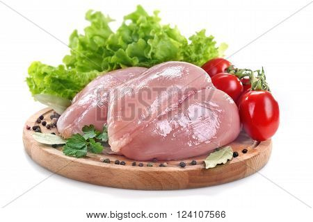 Fresh white chicken breast with tomato salad and spices on a white background