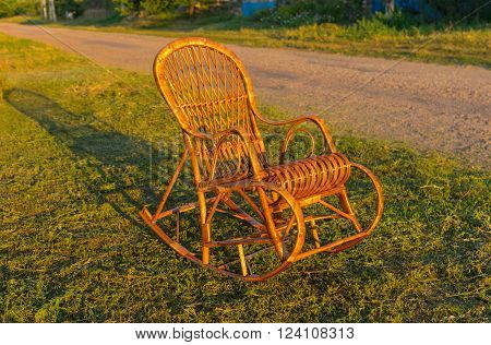 Wicker rocking-chair is waiting for the holiday-maker