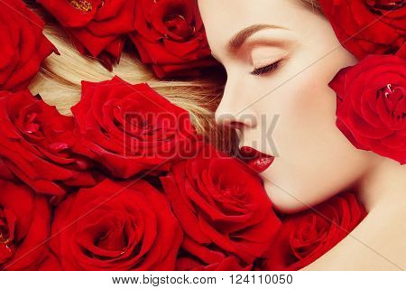 Vintage style profile portrait of young beautiful girl with closed eyes and red roses in her blond hair