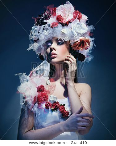 Cute woman wearing hat made of flowers