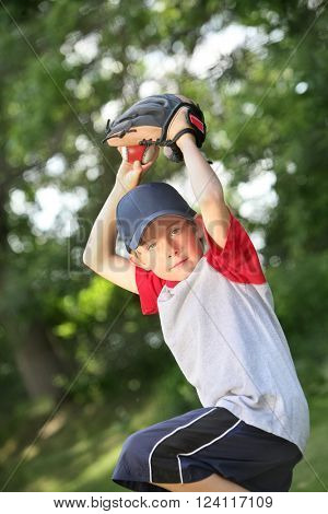 Young boy practicing pitching a baseball