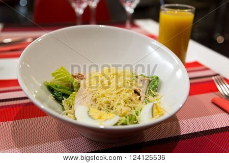 Caesar salad on the table in a restaurant ** Note: Shallow depth of field