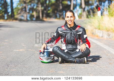 Fermale Motorcycle Rider Sitting In The Street.