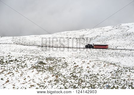 NEW HAMPSHIRE/USA - SEPTEMBER 30 2009: Cog Railway train slowly working its way down Mount Washington