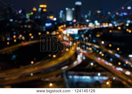 Abstract bokeh light background, city downtown background and highway interchanged nigh view