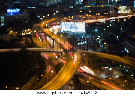 Abstract blurred bokeh lights background, interchanged highway night view