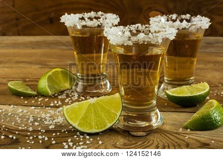 Gold Mexican tequila with lime and salt close up. Tequila. Tequila shot