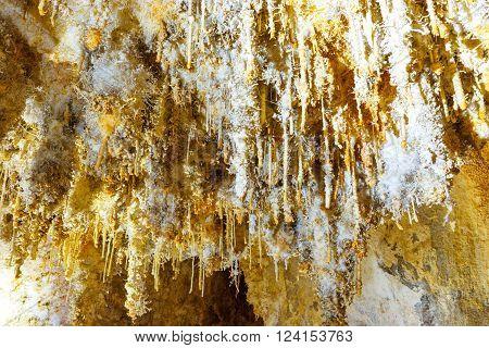 Many White Stalactites Inside Of Cave