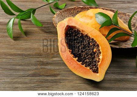 Halved papayas with leaves, close up