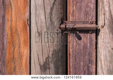 Rustic weathered barn wood background with knots with door lock