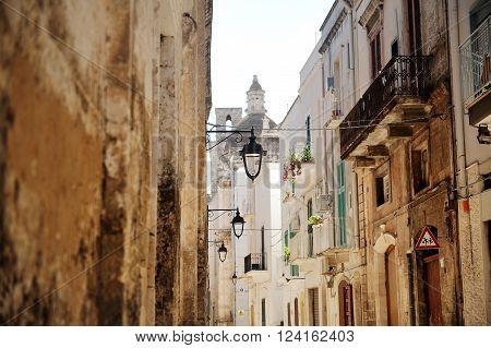 characteristic alley in Monopoli city near Bari Apulia Southern Italy