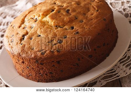 Round Biscuit Cake With Chocolate Chips Close-up. Horizontal