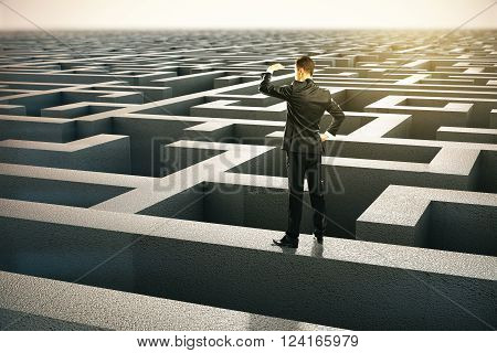 Solution concept with businessman looking into the distance standing on maze wall. 3D Rendering