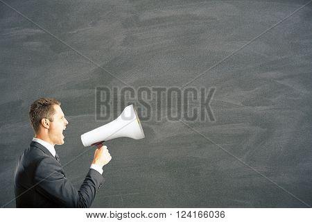 Caucasian businessman shouting into megaphone. Mock up