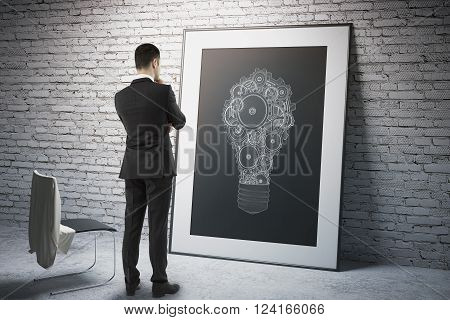 Idea concept with businessman staring at light bulb sketch. 3D Render
