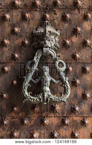 Ancient wooden spiked door detail in Genoa Italy poster