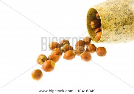the stone jorum is filled with nuts isolated