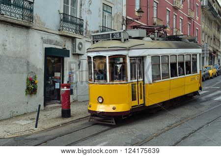Lisbon, Portugal - March 04, 2016: Vintage Tram on the streets of romantic old  Alfama Lisbon Portugal.