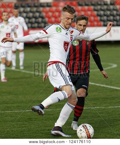 BUDAPEST HUNGARY - APRIL 2 2016: Zsolt Haraszti of Videoton covers the ball from Gergo Nagy of Honved (r) and during Budapest Honved - Videoton OTP Bank League football match at Bozsik Stadium.