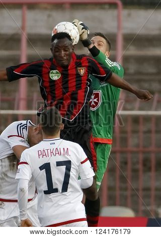 BUDAPEST HUNGARY - APRIL 2 2016: The header of Souleymane Youla of Honved (r) is saved by Adam Kovacsik of Videoton during Budapest Honved - Videoton OTP Bank League football match at Bozsik Stadium.