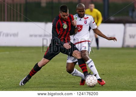 BUDAPEST HUNGARY - APRIL 2 2016: Duel between Endre Botka of Honved (l) and Paulo Vinicius of Videoton during Budapest Honved - Videoton OTP Bank League football match at Bozsik Stadium.