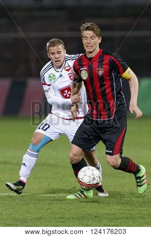 BUDAPEST, HUNGARY - APRIL 2, 2016: Patrik Hidi of Honved (r) and Istvan Kovacs of Videoton during Budapest Honved - Videoton OTP Bank League football match at Bozsik Stadium.
