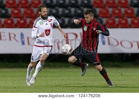 BUDAPEST HUNGARY - APRIL 2 2016: Duel between Endre Botka of Honved (r) and Andras Fejes of Videoton during Budapest Honved - Videoton OTP Bank League football match at Bozsik Stadium.