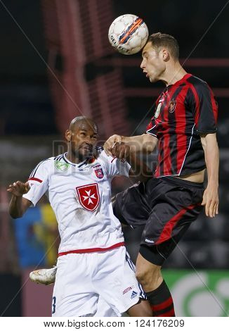 BUDAPEST HUNGARY - APRIL 2 2016: Air battle between Marton Eppel of Honved (r) and Paulo Vinicius of Videoton during Budapest Honved - Videoton OTP Bank League football match at Bozsik Stadium.