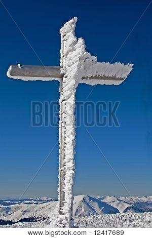 frozen cross on mountain summit