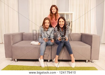 Young Happy Girls Having Party And Playing Video Games