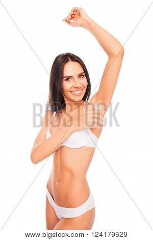 Happy Pretty Young Woman  In White Lingerie Using Antiperspirant