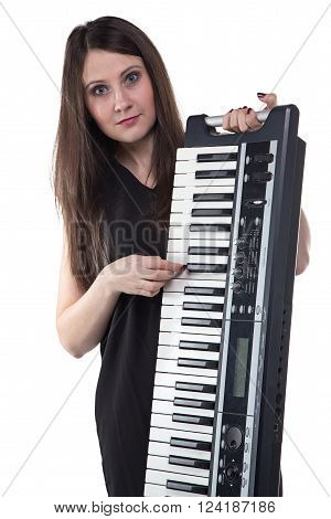 Brunette woman with synthesizer on white background