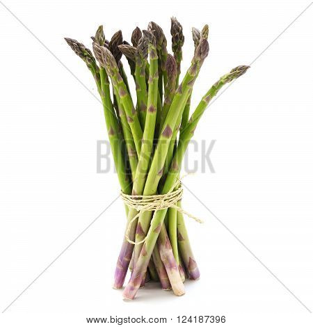 bunch of green asparagus standing isolated with a small shadow against a white background selected focus